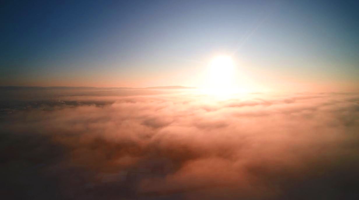 Drone shot over a layer of fog